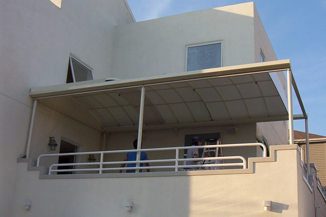 Retractable patio coverings
